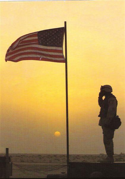soldier saluting the flag