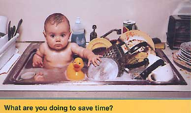 baby taking bath in the sink