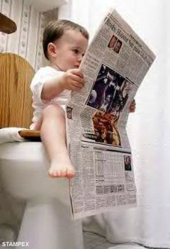 baby reading newspaper on toilet