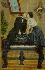 couple kissing on piano